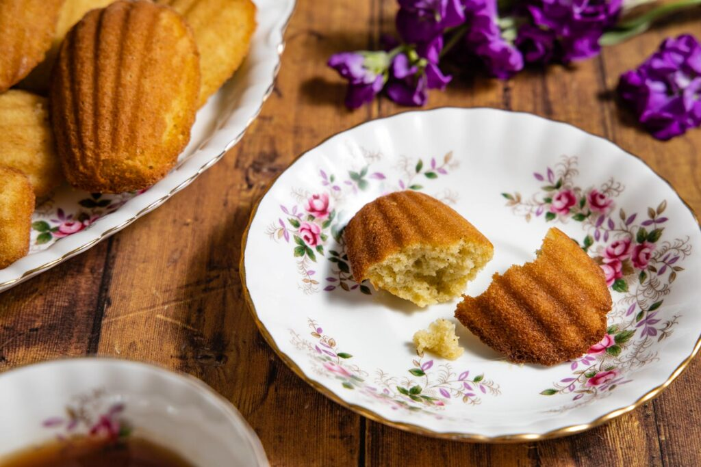 earl grey madeleine on a tea saucer with flowers