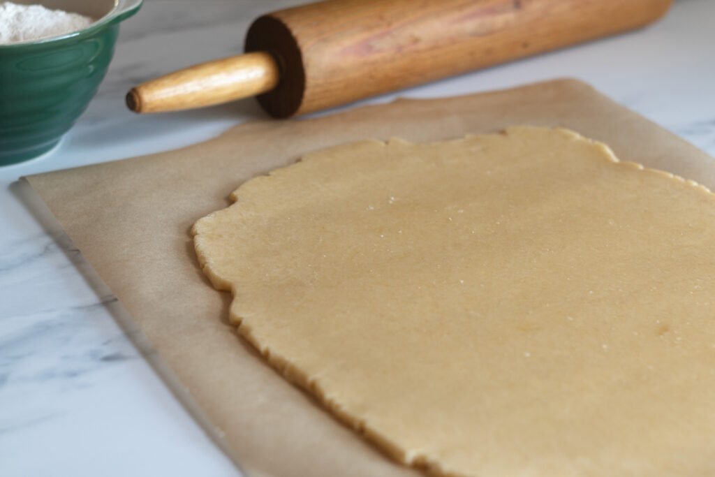 rolling out sable cookie dough