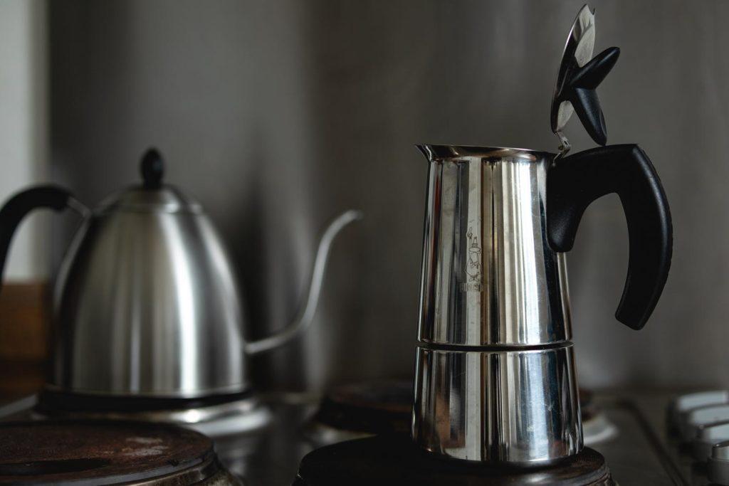 place the moka pot on the stove on low to medium heat