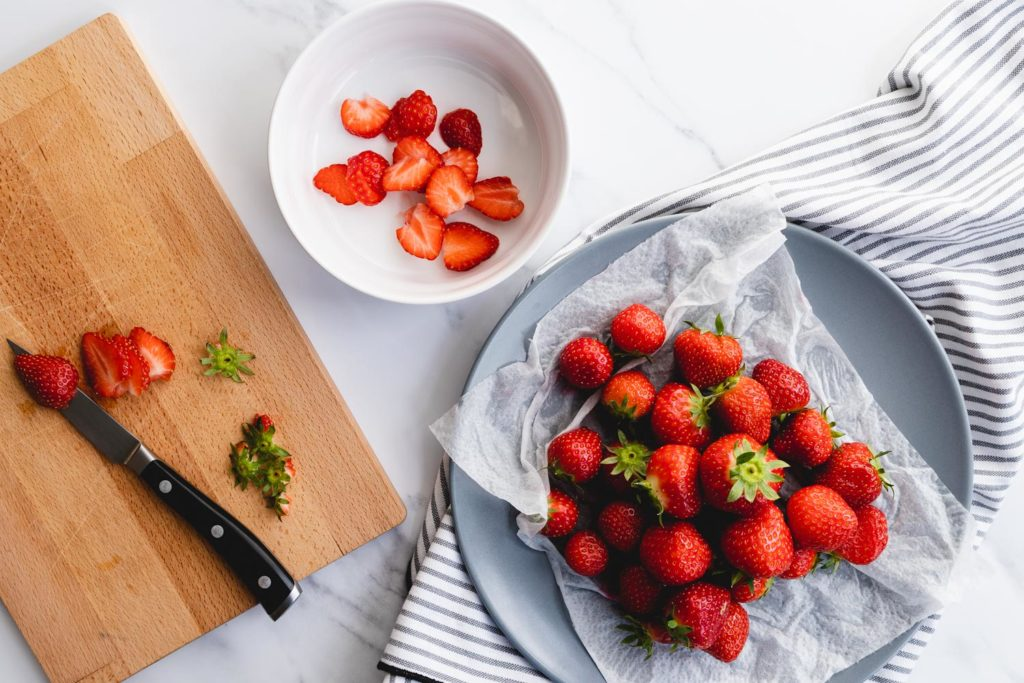 Prepping the balsamic macerated strawberries
