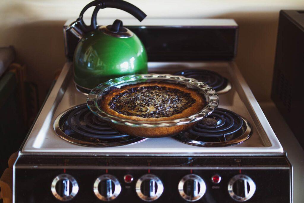 mustikkapiirakka finnish blueberry tart cooling on the stove