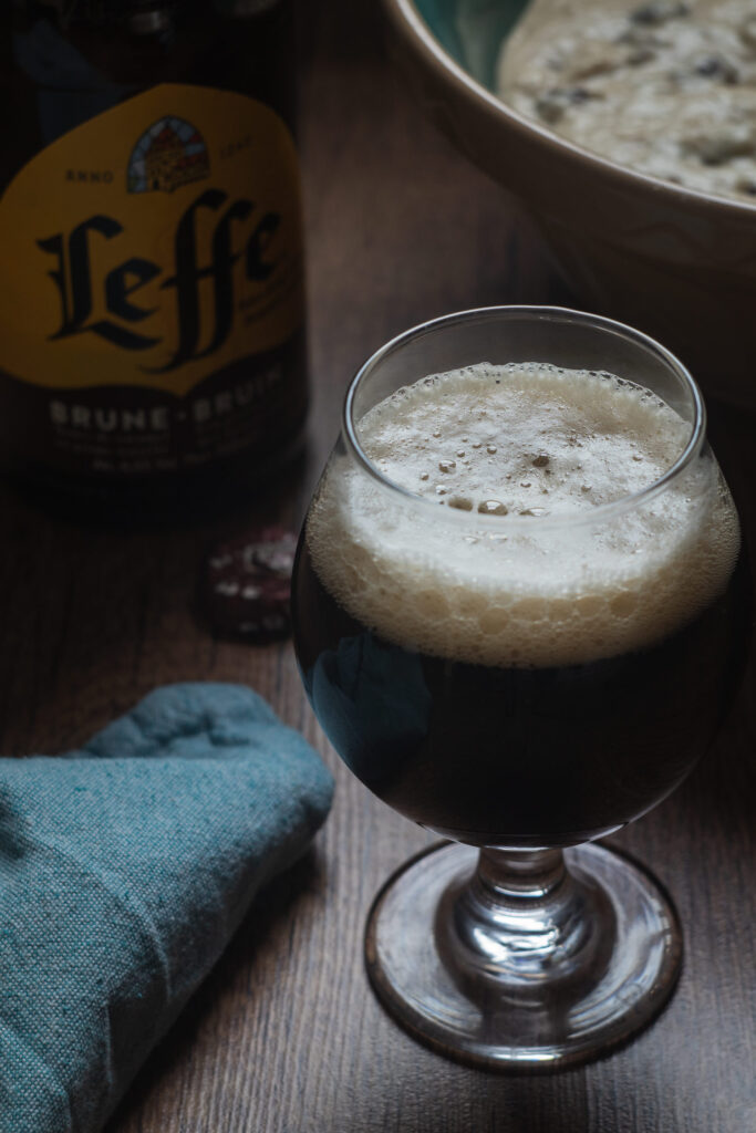 glass of leffe bruin and oliebollen dough