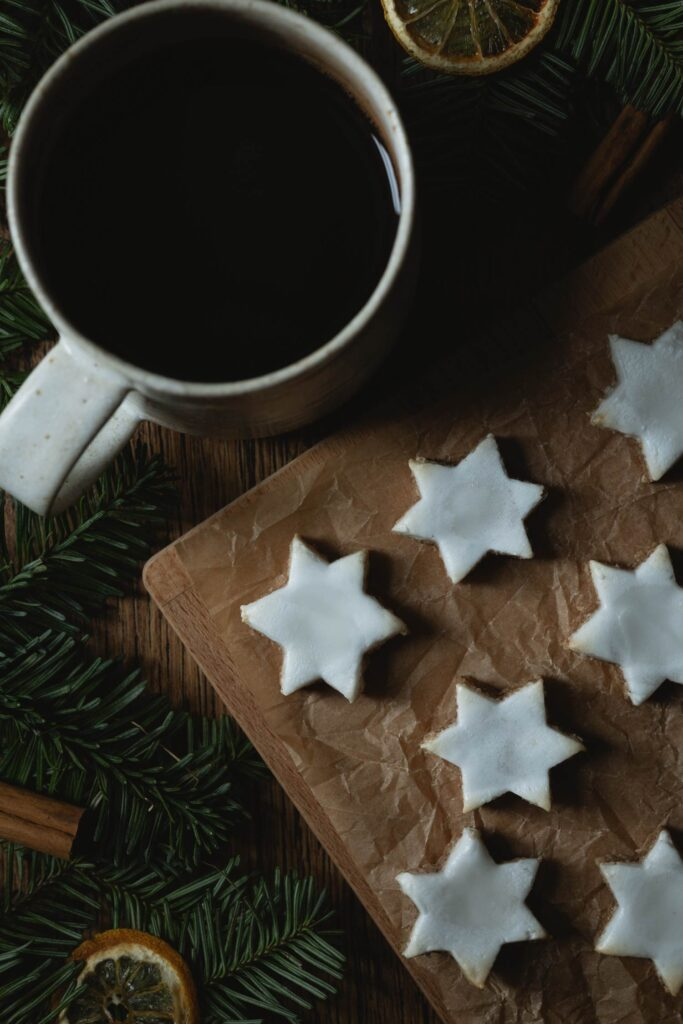 zimtsterne cinnamon star cookies with a cup of coffee