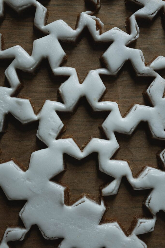 cutting out zimtsterne cinnamon star cookies