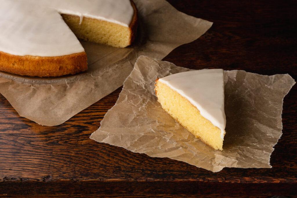 slice of gateau nantais rum cake on parchment paper