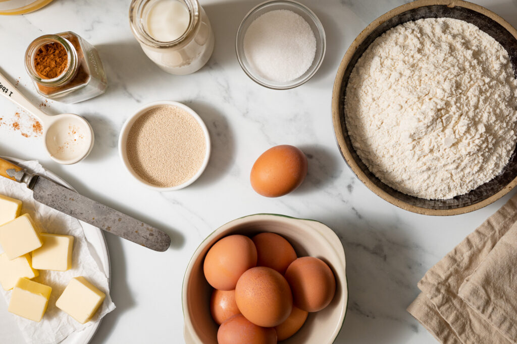 ingredients for zeeuwse bolus cinnamon rolls on a marble surface
