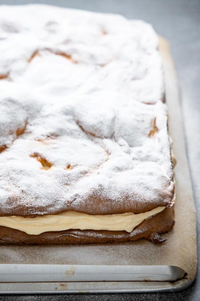karpatka on an overturned baking sheet
