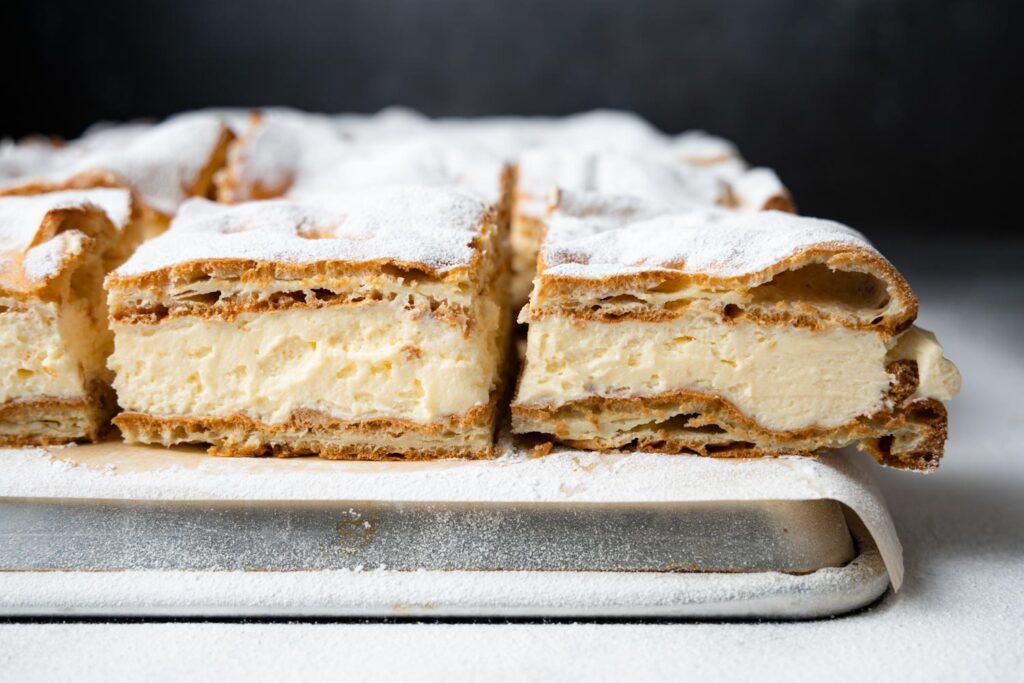 slices of karpatka on an overturned baking sheet