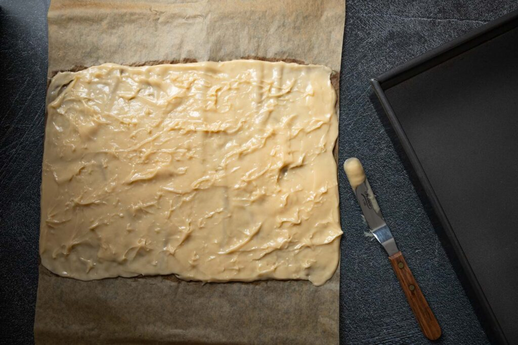 choux paste spread thinly on parchment paper