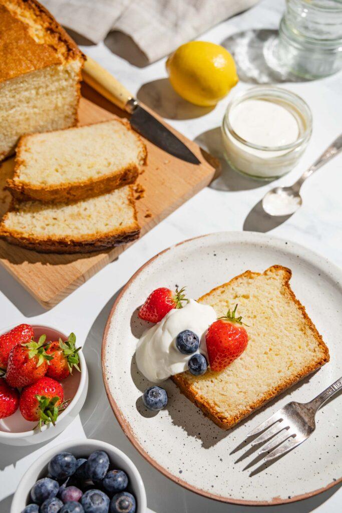 gateau au yaourt slice with blueberries, strawberries, and yogurt